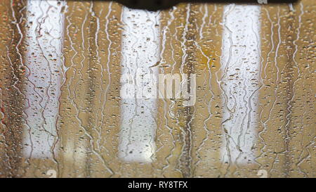 Water dripping on the mirror of the car after going through the carwash machine - Stock Photo