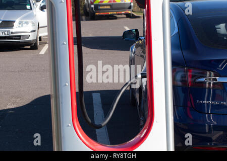 Electrical charging point for cars at Motorway services -M54 - Stock Photo