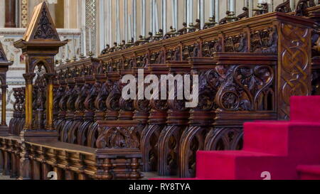 The wooden chairs on the altar in the cathedral in Palermo Sicily Italy where cardinals and priest sits during the mass of the church - Stock Photo