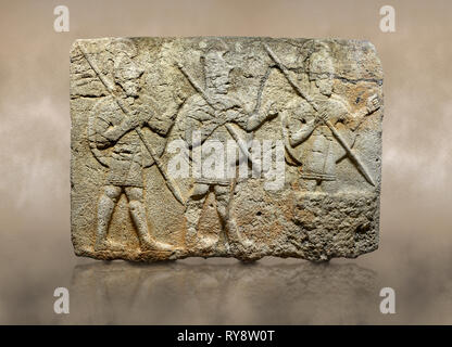 Photo of Hittite monumental relief sculpted orthostat stone panel from the Herald's Wall. Basalt, Karkamıs, (Kargamıs), Carchemish (Karkemish), 900-70 - Stock Photo
