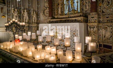The white candles inside the cathedral in Palermo Sicily Italy found infront of the altar of the church - Stock Photo