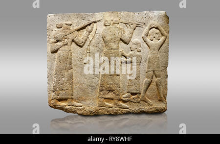 Picture & image of Hittite monumental relief sculpted orthostat stone panel of Procession. Limestone, Karkamıs, (Kargamıs), Carchemish (Karkemish), 90 - Stock Photo