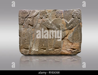 Picture & image of Hittite monumental relief sculpted orthostat stone panel of Procession. Basalt, Karkamıs, (Kargamıs), Carchemish (Karkemish), 900 - - Stock Photo