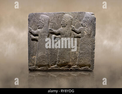 Photo of Hittite monumental relief sculpted orthostat stone panel of a Procession Basalt, Kargamis, Gaziantepe, 900 - 700 B.C. Anatolian Civilisations - Stock Photo