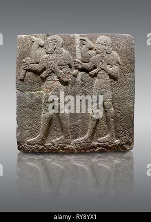 Picture & image of Hittite monumental relief sculpted orthostat stone panel of a Procession Basalt, Karkamıs, (Kargamıs), Carchemish (Karkemish), 900- - Stock Photo