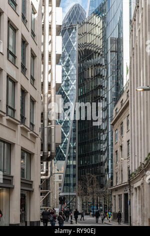 Glass and steel of the City of London's towers loom over City workers in Lime Street. - Stock Photo