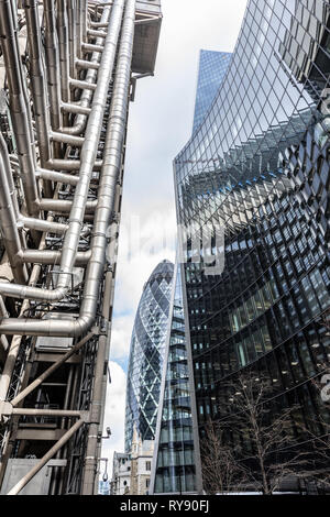 Glass and steel are the materials of choice for the Lloyds of London, 'Gherkin', 'Scalpel', and Willis buildings in the City of London - Stock Photo