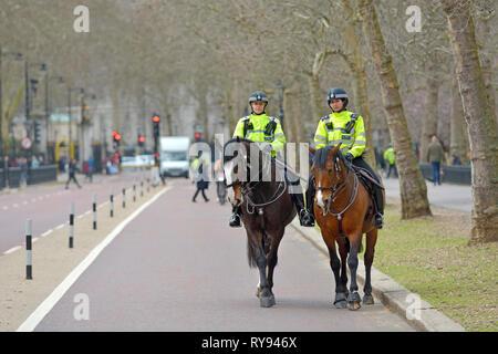 London, England, UK. Metropolitan police officers on horseback in Birdcage Walk, by St James's Park - Stock Photo