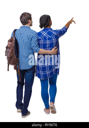 Back view of interracial going couple who points somewhere. Two students go to the lecture. Rear view people collection. backside view of person. Isol - Stock Photo