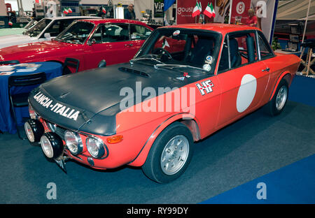 Three-quarter front-view of a Lancia Fulvia 1600 HF on display at the 2019 London Classic Car Show - Stock Photo