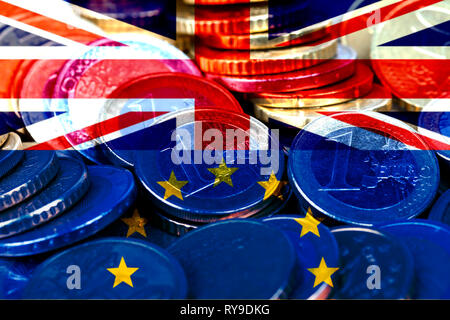 Lots of euro coins with the flags of the United Kingdom and the European Community. Brexit metaphor. - Stock Photo