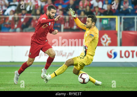 CHORZOW, POLAND - OCTOBER 11, 2018: Football Nations League division A group 3 match Poland vs Portugal 2:3. In action Rafa Silva and goalkeeper Lukas - Stock Photo