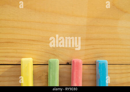 School supplies colored crayons on a light background of the Board stationery. Back to school, the concept of minimalism, flat lay, copyspace - Stock Photo