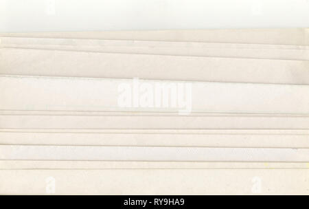stack of old Newspapers on a white background - Stock Photo