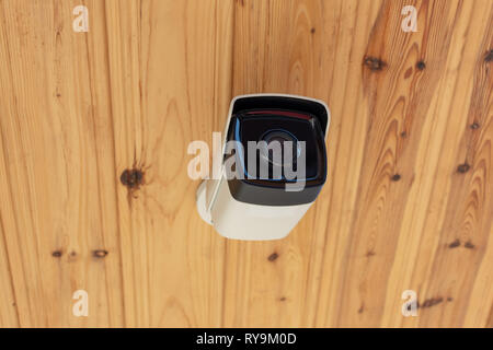 Modern Outdoor CCTV Camera on a Ceiling. Concept of Surveillance and Monitoring. Surveillance camera Anti-theft System Concept. - Stock Photo
