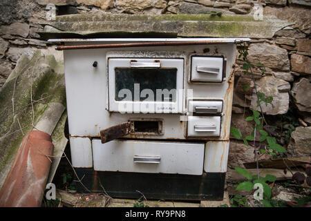 Abandoned stove in an abandoned village Slapnik in region Goriška Brda, Slovenia. - Stock Photo