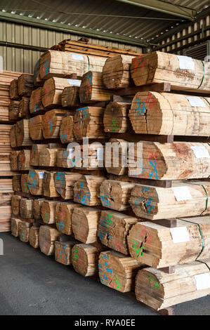 Stacks of sliced logs in warehouse - Stock Photo