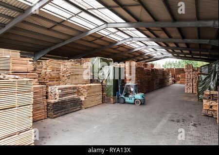 Forklift in lumber warehouse