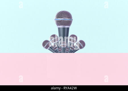 levitating microphones on a azure pink background, microphones in the air - Stock Photo