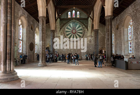 Winchester, Hampshire, England, UK, Students on an educational vitsit to the historic Great Hall. King Arthurs Round Table is mounted on the wall. - Stock Photo