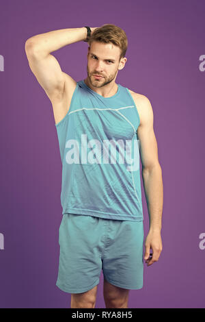 Sportsman after training feel pleasant aroma. Guy check armpit dry skin. Prevent or reduce perspiration. Choose proper antiperspirant or deodorant for - Stock Photo