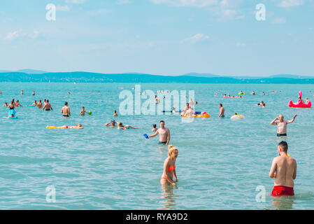 BALATON, HUNGARY - July 14, 2018: people swimming in blue azure lake - Stock Photo