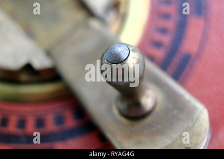 Old german roll measuring tape handle, isolated on white background, close-up - Stock Photo