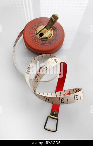 Old german roll measuring tape, isolated on white background, close-upnumb - Stock Photo