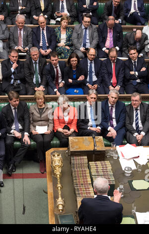 London, Britain. 12th Mar, 2019. British Prime Minister Theresa May (3rd L, Front) is seen during the Brexit deal vote in the House of Commons in London, Britain, on March 12, 2019. British Prime Minister Theresa May's Brexit deal was rejected again on Tuesday by MPs in the second meaningful vote in the parliament since January, increasing uncertainty about how the country will leave the European Union. Credit: UK Parliament/Jessica Taylor/Xinhua/Alamy Live News - Stock Photo