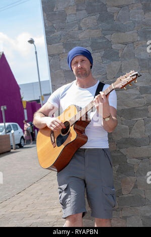 Busker Russell Steele, accused of murdering Colombian partner and teenage daughter in Newry apartment, performing in Banbridge's Buskfest Competition, 23 June 2018. Northern Ireland - Stock Photo