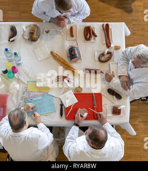 Erfurt, Germany. 13th Mar, 2019. During the sausage test at the 23rd Day of Thuringian Sausage Specialities, jurors will evaluate several types of sausage from Thuringia. The event takes place as part of the Thuringia exhibition (9.-17.3.) at Messe Erfurt. Credit: Michael Reichel/dpa/Alamy Live News - Stock Photo