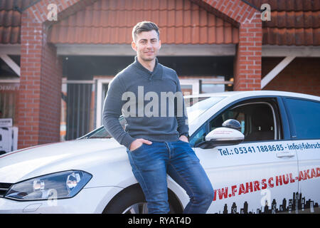 Lengede, Germany. 05th Mar, 2019. Tom Gerhard Tiessen, head of the A and G Driving Academy, stands in front of a driving school car. (to dpa 'driver's license cheaper? Driving instructor sues against VAT' of 13.03.2019) Credit: Christophe Gateau/dpa/Alamy Live News - Stock Photo