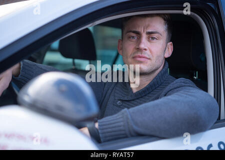 Lengede, Germany. 05th Mar, 2019. Tom Gerhard Tiessen, head of the A and G Driving Academy, sits in a driving school car. (to dpa 'driver's license cheaper? Driving instructor sues against VAT' of 13.03.2019) Credit: Christophe Gateau/dpa/Alamy Live News - Stock Photo