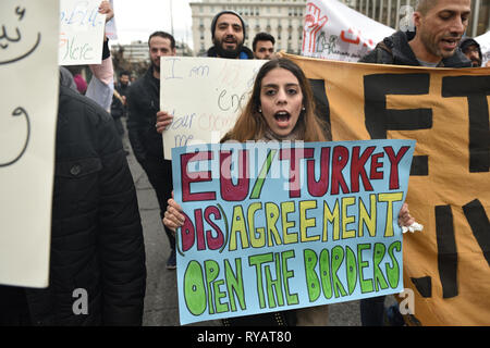 Athens, Greece. 13th Mar 2019. Refugees and supporters march chanting slogans demanding from the EU and the Greek government funds for the refugee rental housing program in Athens, Greece. Credit: Nicolas Koutsokostas/Alamy Live News. - Stock Photo