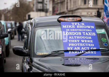 LONDON, UK - March 13th 2019: Black cabs block roads around Westminster in protest over plans to ban them driving on roads in parts of London Credit: Ink Drop/Alamy Live News - Stock Photo