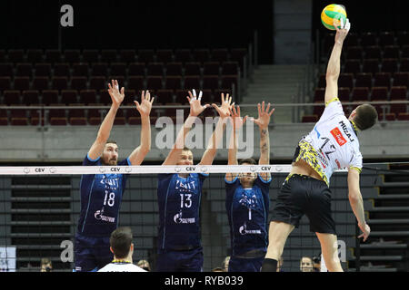 Gdansk, Poland March, 13th. 2019 Trefl Gdansk (Poland) v Zenit Kazan (Russia) CEV Champions League Men - Quarter Finals volleyball game. MACIEJ MUZAJ (12) of Trefl Gdansk is seen in action against MATTHEW ANDERSON (1) of Zenit-Kazan, ALEXEY SAMOYLENKO (13) of Zenit-Kazan, MAXIM MIKHAILOV (18) of Zenit-Kazan © Vadim Pacajev / Alamy Live News Stock Photo