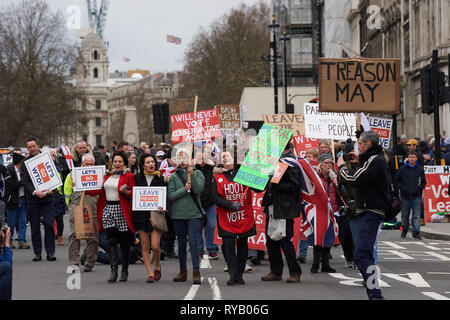 London, UK. 13th Mar, 2019. 13th March 2019  Brexit campaigners outside the Palace of Westminster on the day Prime minister May loses the vote and removes No Deal from the Brexit negotiations Credit: Thomas Bowles/Alamy Live News - Stock Photo