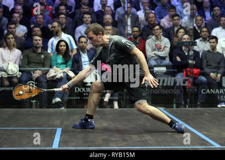 London, UK. 13th Mar, 2019. Mathieu Castagnet of France  in action against Fares Dessouky of Egypt . Citigold Canary Wharf Squash Classic, day 4, Quarter-finals, at the East Wintergarden in Canary Wharf , London on Wednesday 13th March 2019.   pic by  Steffan Bowen/Andrew Orchard sports photography/Alamy Live news - Stock Photo