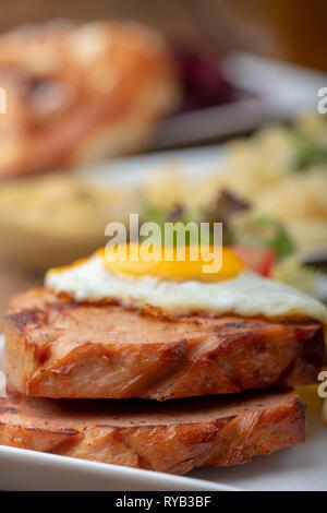 closeup of a bavarian leberkaese with egg - Stock Photo