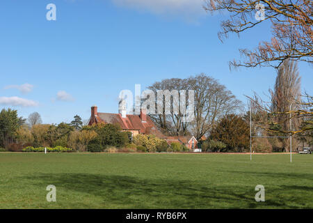 Sports pavillion and playing fields at Oxford University Parks in winter / spring - Stock Photo