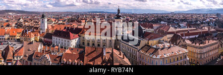 Aerial view from Saint Mary Lutheran Cathedral in Sibiu city in Romania - Stock Photo