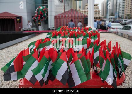 November 28, 2018 - Abu Dhabi, UAE: bundle of  small UAE flags - Stock Photo