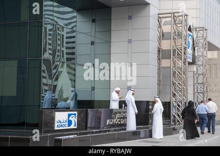 November 28, 2018 - Abu Dhabi, UAE: UAE local men having chit chat in front of ADNOC drilling head office in Abu Dhabi - Stock Photo