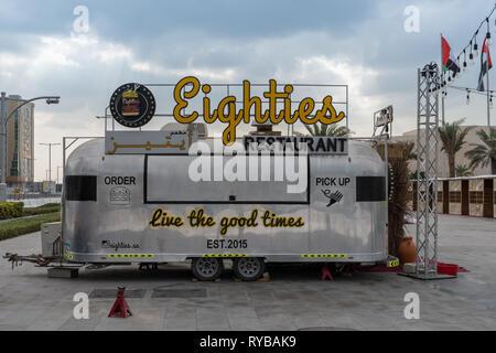 November 28, 2018 - Abu Dhabi, UAE: A vintage trailer food truck named Eighties Restaurant - Stock Photo