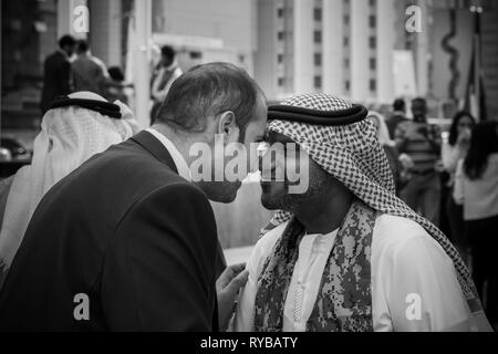 November 28, 2018 - Abu Dhabi, UAE: Local emirati men greeting each other - Stock Photo