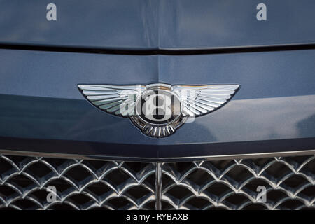 November 28, 2018 - Abu Dhabi, UAE: Close up of a Bentley logo on front of Bentley car - Stock Photo