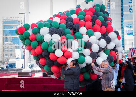 November 28, 2018 - Abu Dhabi, UAE: Hundreds of red, green, white and black ballons are brought for realse in the air on UAE flag Day - Stock Photo