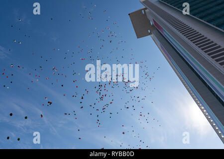 November 28, 2018 - Abu Dhabi, UAE: Hundreds of red, green, white and black ballons  realsed in the air on UAE flag Day - Stock Photo