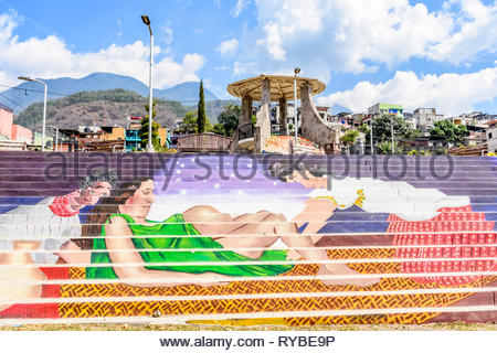 Santiago Atitlan, Lake Atitlan, Guatemala - March 8, 2019: Colorful mural of woman in childbirth by public park in largest lakeside town - Stock Photo