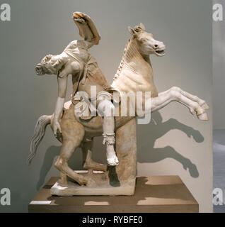 Wounded Amazon on horseback. Marble sculpture (2nd century AD) from a Greek original of the 2nd century BC. Naples. Italy. - Stock Photo